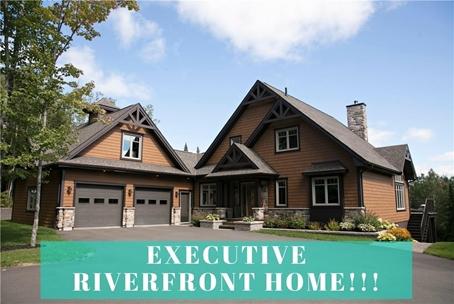 Executive Riverfront Home
