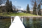 2.5 acres with 190 ft of frontage on prestigious Snake Road in Lake Geneva