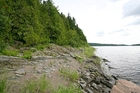 15.56 Acres of Sunset Waterfront, Millidgeville!